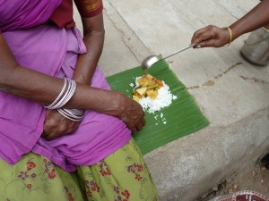 Woman in bus stand, hot rice