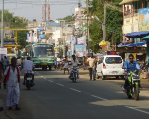 Woman in bus stand, street view